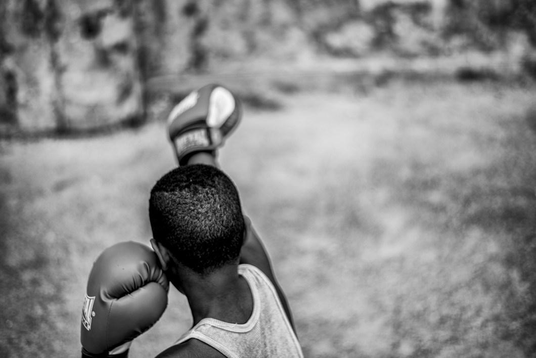 """Boys between 6 and 10 years old practice boxing in the boxing school, """"Gimnasio de Boxeo Ninos de Cuba"""" in Havana, Cuba. - PHOTO: Henry Milleo"""