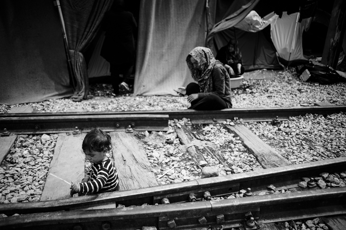 idomeni - Greece april2016 - mother and daughter sitting on the rail way