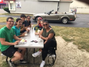 Students enjoying ice cream after the baseball game at Bertson Field house.