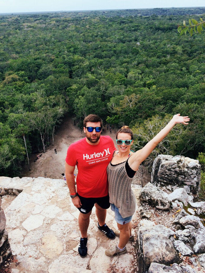 at the top of Cobá, the tallest Mayan pyramid at the top of the jungle!