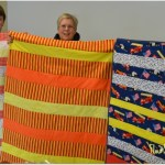 Volunteers Make Light Work of Heavy Hearted Quilting Mission