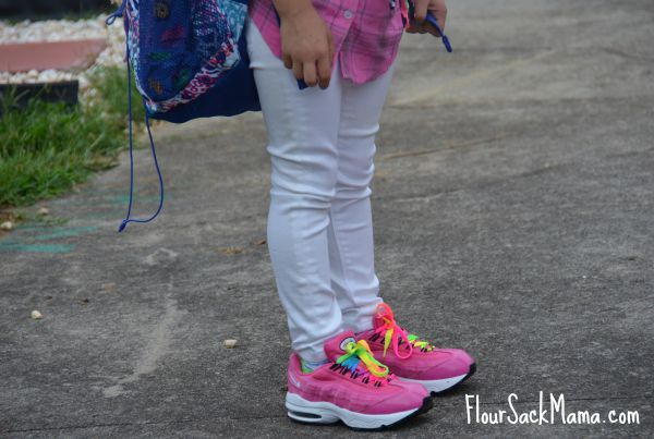 back to school girl white jeans and pink shoes