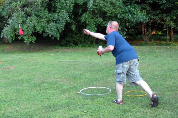 Man playing with lawn darts