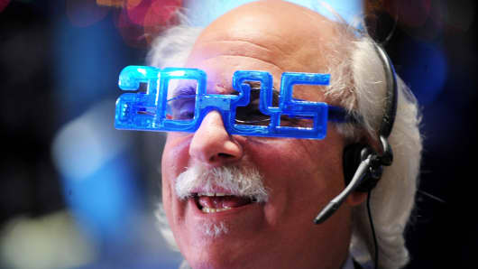 NYSE trader with 2015 glasses