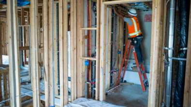A contractor works on a townhouse under construction at the Pulte Homes Inc. Pepper Lane development in San Jose, California.