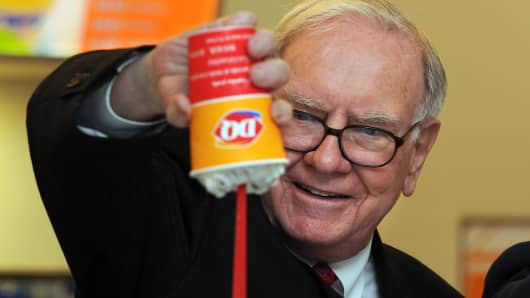 Billionaire investor Warren Buffett flips over a Dairy Queen Blizzard, the most successful product ever released by Dairy Queen.