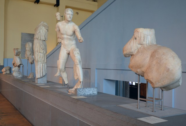 The reconstructed pediment of the Temple of Apollo Sosianus with sculptures narrating the battle between the Greeks and the Amazons, sculptures are Greek originals (c. 450 - 425 BCE), brought to Rome in the Augustan period Centrale Montemartini, Rome museum. Photo © Carole Raddato.