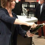 CH sommelier opens a bottle of bubbly with a sword