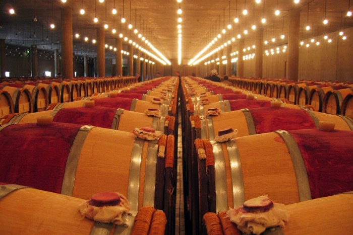 Wine barrels in wine warehouse