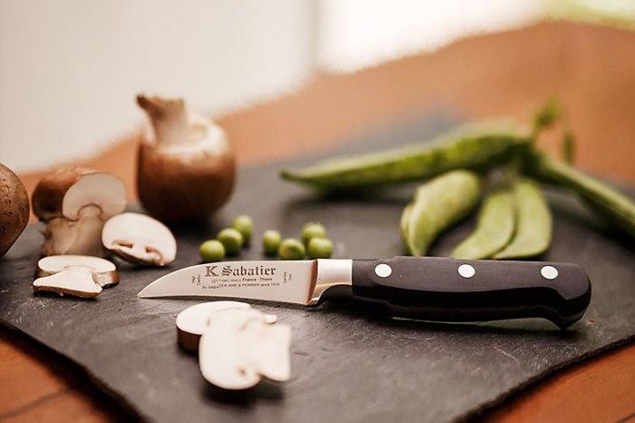 Small knife on slate chopping board
