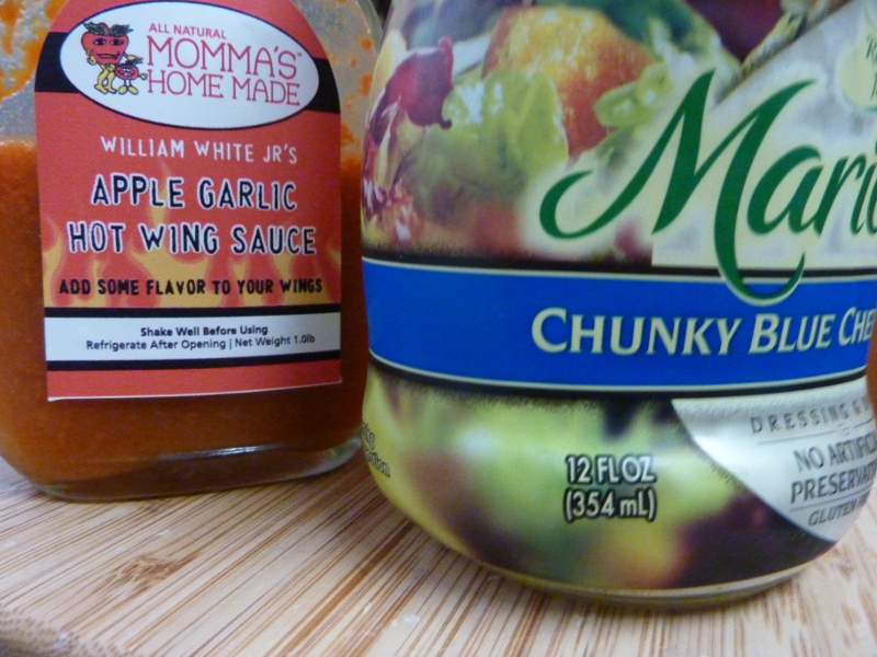 I usually go for franks red hot wing sauce but I was recently gifted this amazingly good Apple Garlic wing sauce which made a great addition.  I like the Marie's Chunky Blue Cheese.  Your gonna want those chunks.
