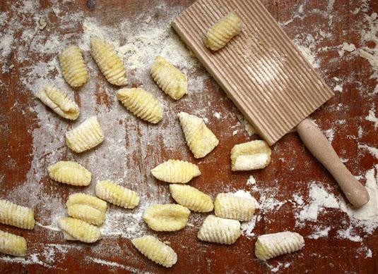 Homemade gnocchi rolled on a gnocchi board