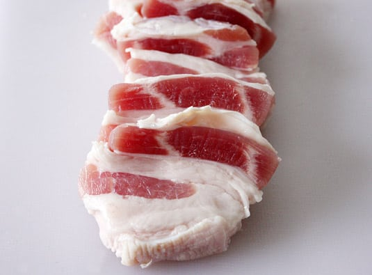 Thick slices of pork jowl.