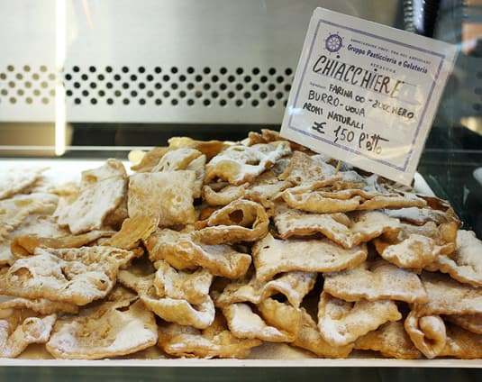 Chiacchiere: Fried (or baked) dough sprinkled with powdered sugar. A classic. 