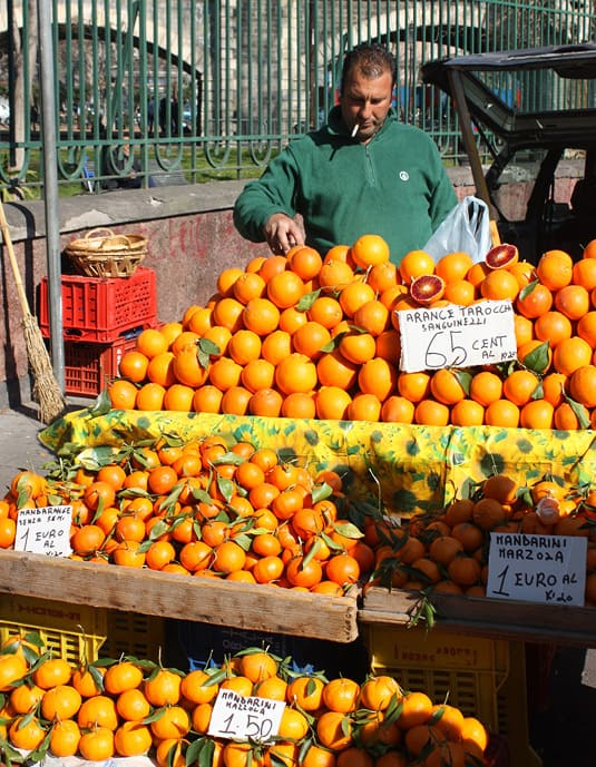 An man selling oranges along Catania's fortifications - he was literally unloading the oranges off his trunk