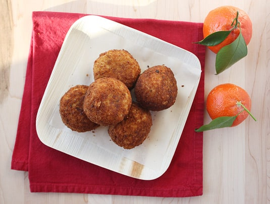 These fried rice balls are called arancine because they're small and orange in color, like oranges, of course!