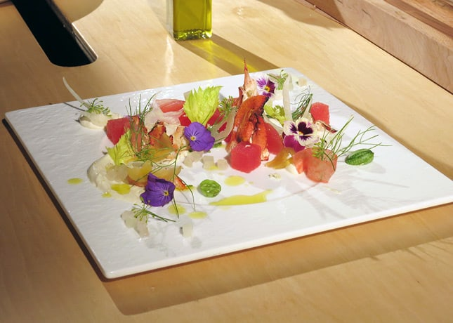 Chef Holmes' second dish included Pernod-marinated watermelon, lobster, pickled watermelon rind, candied fennel, fennel flowers, celery leaves, miniature cucumbers, edible flowers and bergamot oil.  At the Omnivore Food Festival, Montreal / FoodNouveau.com