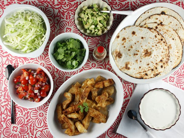 Batter-Free Fish Tacos with Pico de Gallo, Salted Cabbage & Lime Crema // FoodNouveau.com
