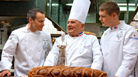 Chef Phillip Tessier and his commis, Skylar Stover, celebrate with the god, Paul Bocuse at 2015's competition. Photo: Jason Kessler