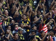 KUALA LUMPUR, MALAYSIA - SEPTEMBER 08: Malaysian fans cheer during the 2018 Russia FIFA World Cup and 2019 UAE Asian Cup Preliminary Round 2 joint qualifying match between Malaysia and Saudi Arabia at the Shah Alam Stadium on September 8, 2015 in Kuala Lumpur, Malaysia.  (Photo by Stanley Chou/Getty Images)