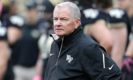 Wake Forest head coach Jim Grobe looks on before an NCAA college football game against Maryland in Winston-Salem, N.C., Saturday, Oct. 19, 2013. (AP Photo/Chuck Burton)