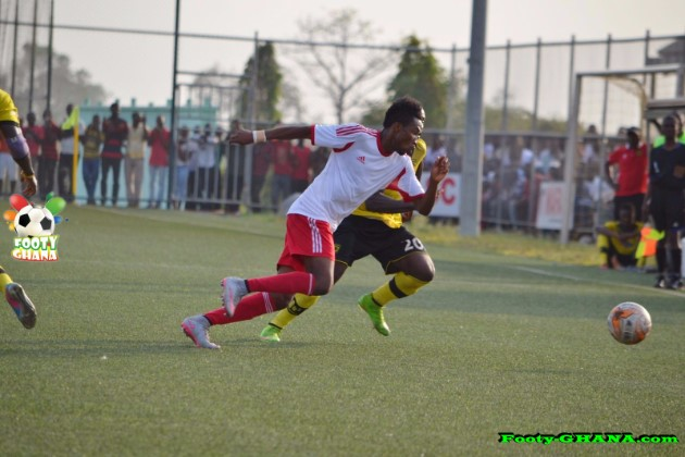 Samuel Tetteh [in white] attempts to outpace Kotoko's Amos Frimpong
