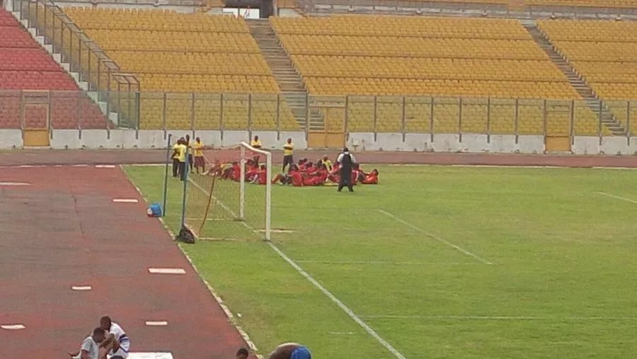 Kotoko players listening to instructions from interim coach Michael Osei at the Baba Yara Stadium