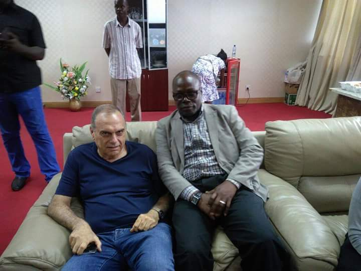 Avram Grant poses for a picture with an official of Azam