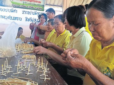Senior citizens are making Thai sweets at a workshop run by The Foundation For Older Person's Development.