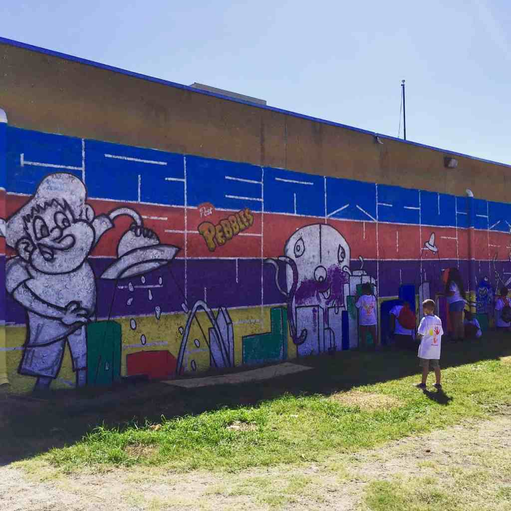 colorful mural on outer wall of the Boys and Girls Club of OakCliff
