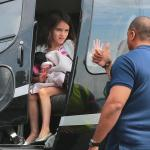 Suri Cruise waves goodbye to her bodyguard when departing NYC via helicopter with mom Katie Holmes in tow