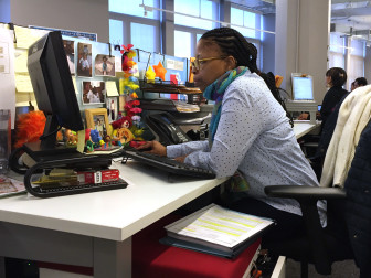 Karen Savage working at her desk computer.