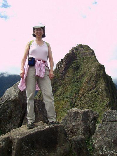 Jean standing a top Huchuy Picchu at Machu Picchu, Urubamba Province, Peru