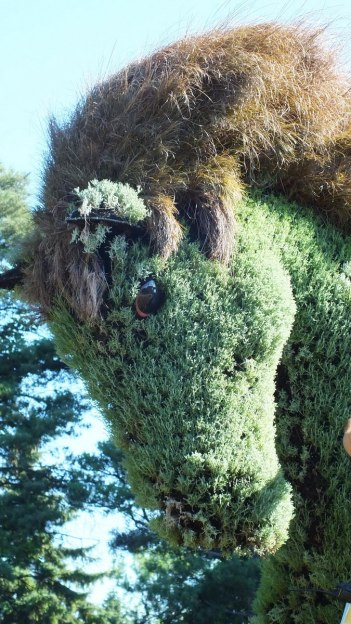 Close up of a horse head in The Man Who Planted Trees topiary at Mosaiculture 2013 at Montreal Botancial Garden, Montreal, Quebec, Canada