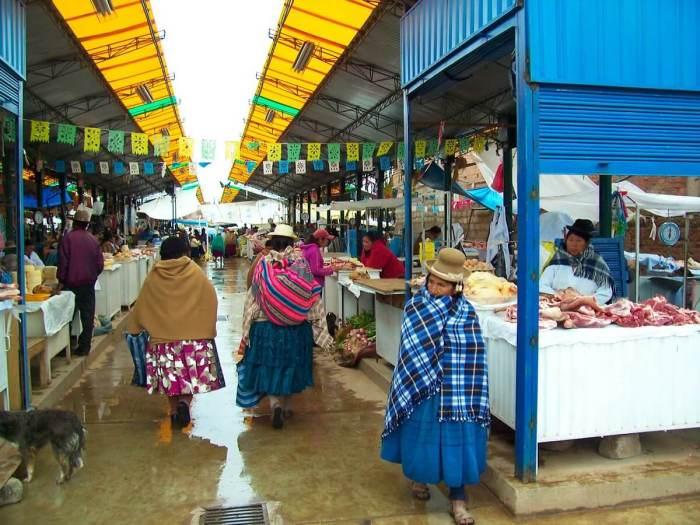 Indigenous native people in puno market - peru
