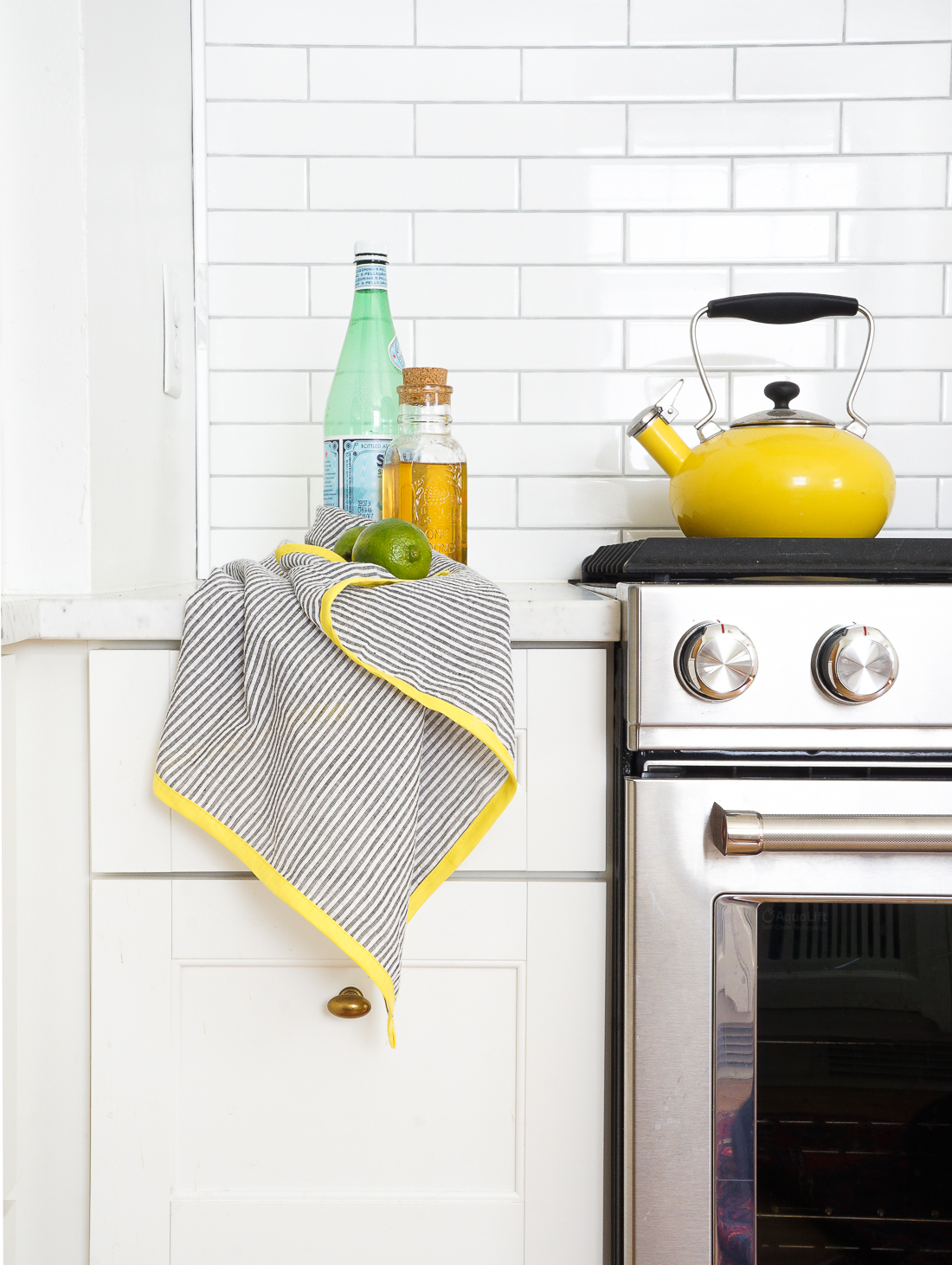 Learn how to make these colorful seersucker tea towels for your kitchen! Click to learn more!