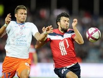 Lille's Serbian defender Marko Basa (R)