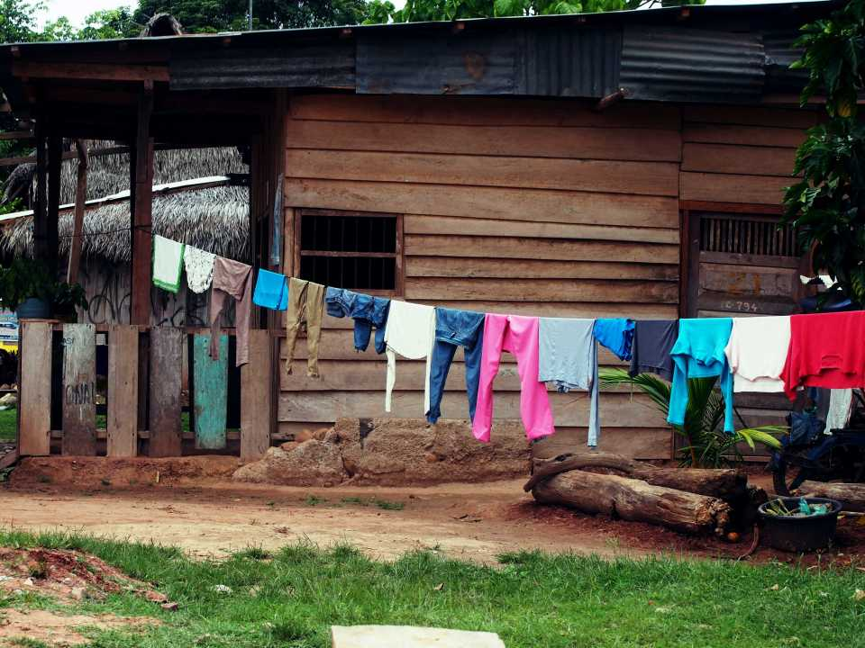 Their are some homes made with wooden boards, often times looking as if patched together, as seen in this picture.