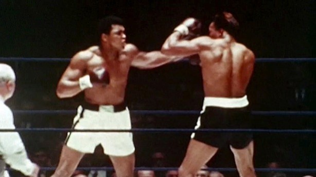 "Vintage footage of boxing legend Muhammad Ali (left) is featured in the forthcoming ""Moment Of Loud"" vignette. (ESPN)"