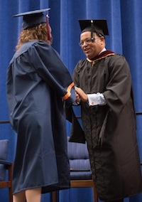 Mike Tirico participates in the commencement ceremony at Syracuse University. (Photo credit: Syracuse University)