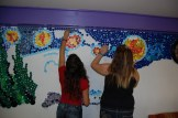 members continue to work on the wall