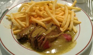 Rare steak with frites and their secret sauce.