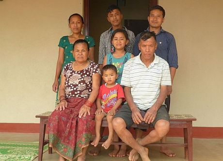 Sixty-year-old Sirku Tamang (bottom right) lost his family's home in the April 25, 2015 earthquake that struck Nepal. Now, he lives in a new Fuller Center home with his wife, 20-year-old daughter, two teenage sone and two granddaughters.