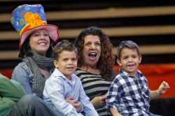 Jacey Byrne, Jameson Adler, 6, Starr Adler and Jaxson Adler, 4, cheer as big cats perform during a small Ringling Bros. and Barnum & Bailey show for military families organized by Blue Star Families at Hampton Coliseum Thursday afternoon.