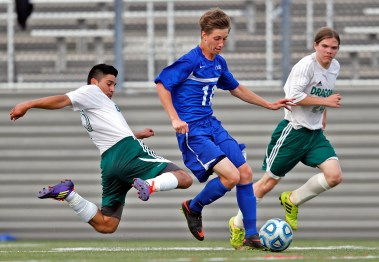 York's Bailey McClure, center, dribbles the ball through the defense of Park View's Adrian Guerrero, left, and Allen Tucker, right, during Tuesday's Conference 25 soccer semifinals at Wanner Stadium. (Photo By Jonathon Gruenke)