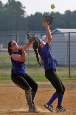 York's Hannah Hautz, left, and Destiny Martinez, right, chase after a pop fly during Wednesday's game against Smithfield.