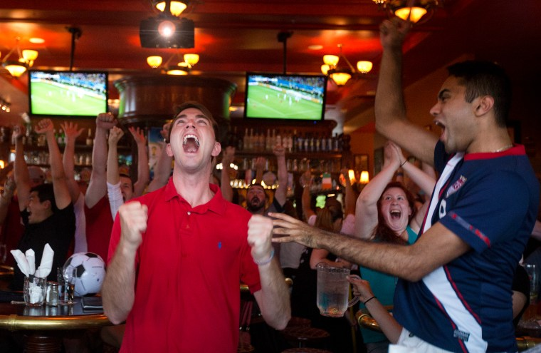 Travis Greiner, left, reacts after watching the United States score a second goal during Monday's World Cup match against Ghana at Park Lane Tavern in Hampton.