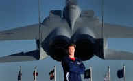 Grafton swimmer Jonathan Spires is photographed with an F-15 Eagle on display at Langley Air Force Base. The F-15 is a twin-engine, all-weather tactical fighter that went into service in the 1970's.