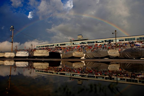 A rainbow appears over Langley Speedway after a brief rain storm forced drivers to cover their cars before the start of Saturday's Hampton Heat.
