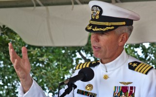 Outgoing Capt. Karl O. Thomas makes his final remarks as he relinquished command of the USS Abraham Lincoln to his brother-in-law U.S. Navy Capt. Ronald Ravelo. (Photo by Joe Fudge)